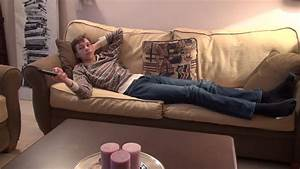 Leisure time, bored teenage boy watching TV, lying on a ...