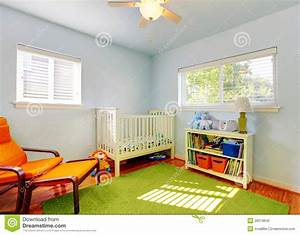 Baby Nursery Room Design With Green Rug, Blue Walls And