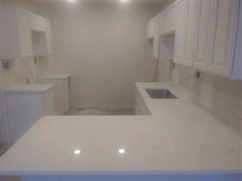 carrara marmi  quartz installation gallery granite