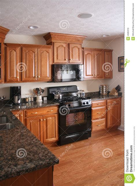 kitchen wood cabinets black stove stock photo image