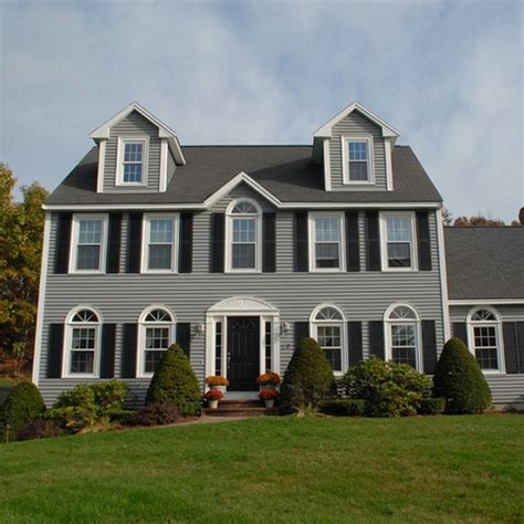 beautiful colonial style home with newpro siding windows