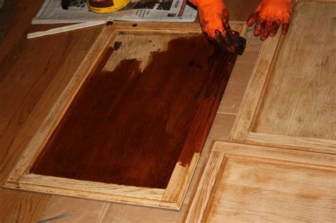 Restaining Hardwood Floors Diy by Restaining Kitchen Cabinets Darker Sanding Staining
