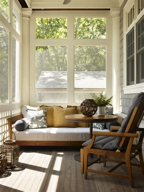 back porch covered screened patio with teak sofa