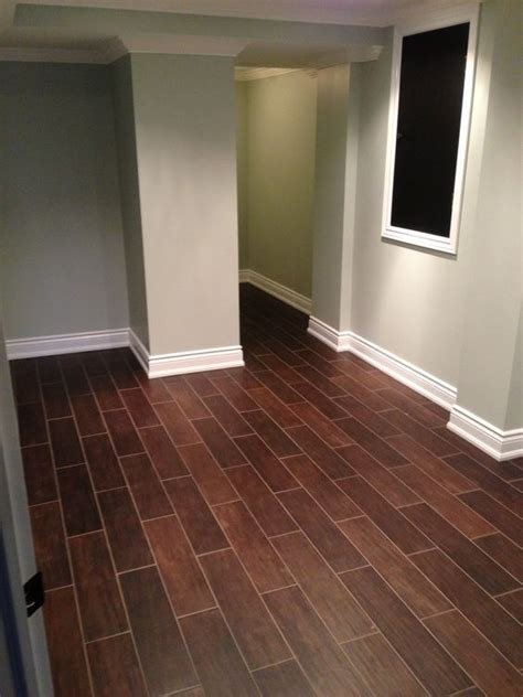 Hardwood floor alternative. Hardwood styled tile dark