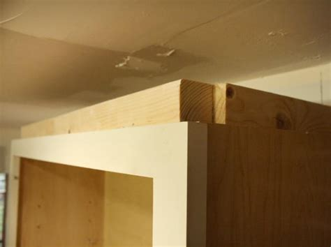 cutting crown molding for kitchen cabinets how to install cabinet crown molding how tos diy 9530