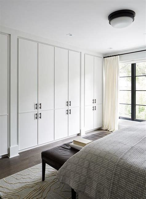 Wall To Wall Cupboards by Wall Of Floor To Ceiling Closet Cabinets Modern Bedroom