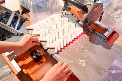 how to install a marble herringbone tile backsplash in the