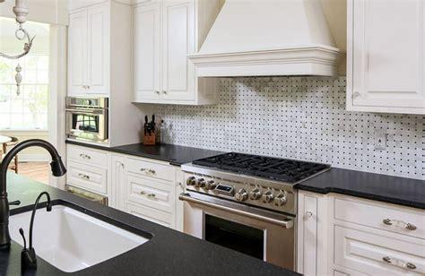 black and white tile backsplash kitchen backsplash with black granite countertops and