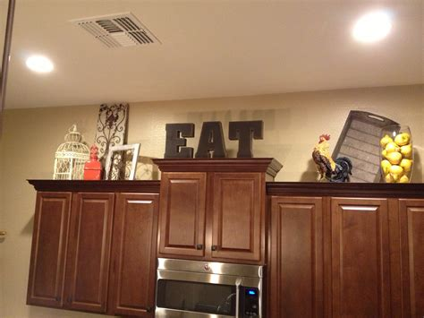 decorating ideas on top of kitchen cabinets 12 best ideas of top of kitchen cabinet decorating ideas 9843