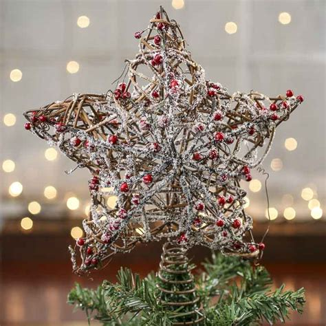 snowy rustic twig and berry star tree topper trees