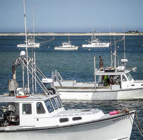 Cape Cod Boats by Fishing Boats Moored In Chatham Harbor On Cape Cod