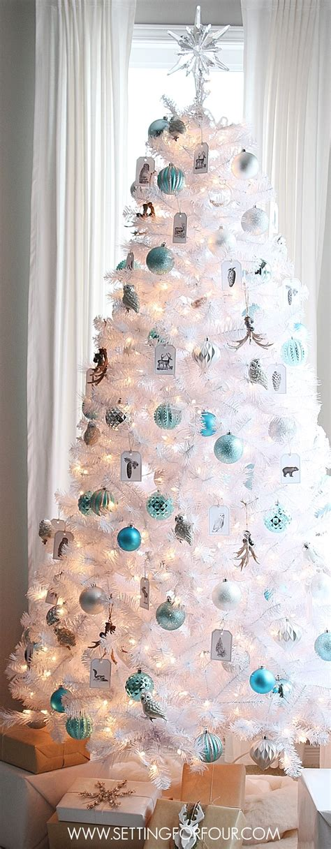 winter woodland glam white christmas tree setting for four