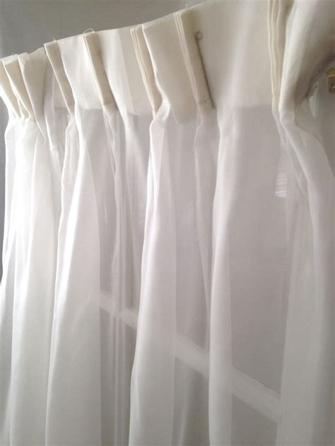 two ivory white sheer pinch pleated curtain