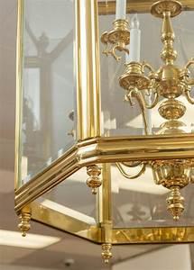 Monumental brass and glass twelve light foyer pendant for