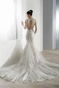 lace v neck long sleeved gown with dramatic key hole back With wedding dresses with dramatic backs