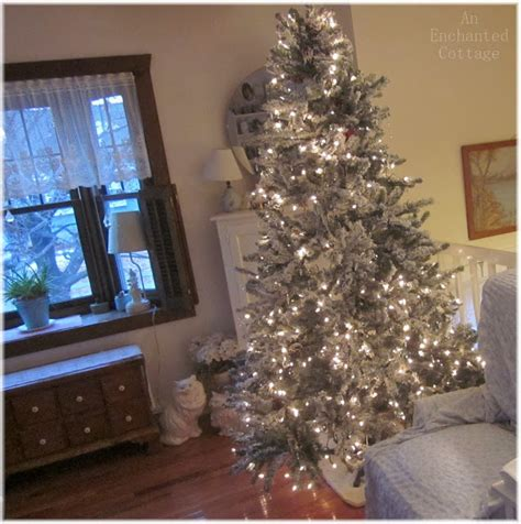 an enchanted cottage of flocked deer flocked trees and