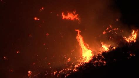 holy fire    acres   moves close  homes