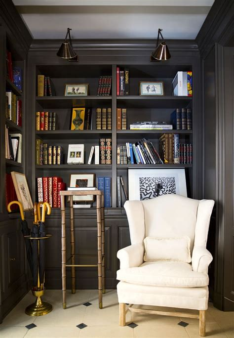 cozy reading corner  built  library shelves brass