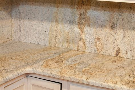leathered kashmir gold granite eclectic kitchen