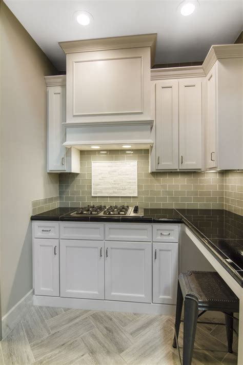 herringbone tile floor kitchen contemporary with accent glass subway tile with a faux wood tile herringbone floor