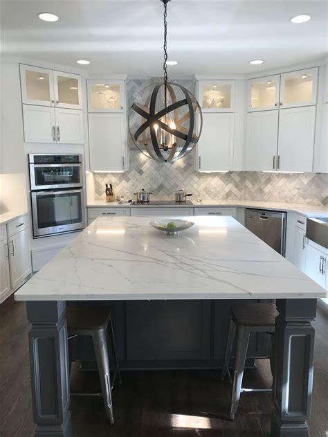 quartz counters marble backsplash white cabinets grey