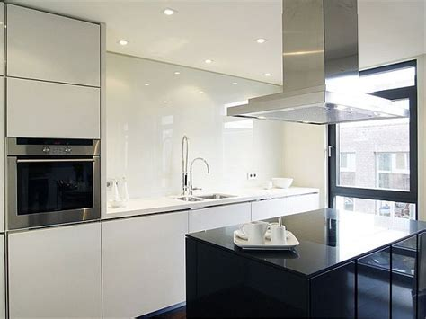 Stylish white lacquered kitchen with island