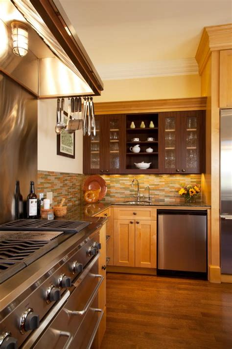 earthy palette  kitchen  honey colored cabinets hgtv