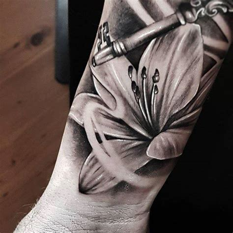 realistic lily flower tattoo  forearm  garage ink