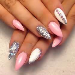 Pink white and silver stiletto nail art with rhinestones accents