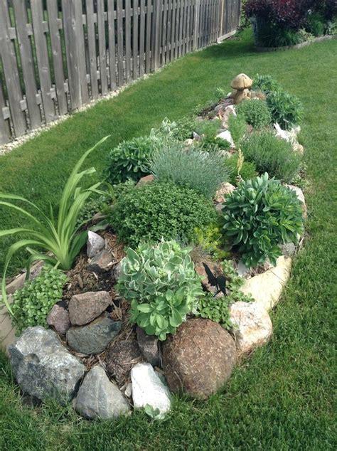 rock bordered garden herbs etc gardening ideas tips