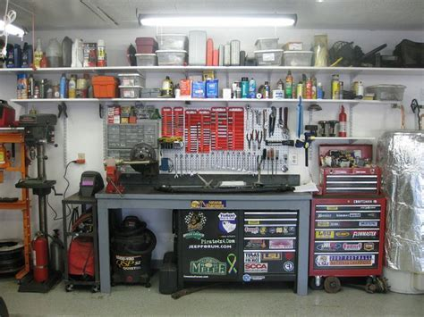 Peg board, welding cart, shelves everywhere.   Garage and