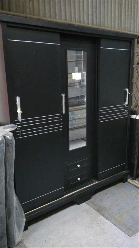 jual lemari pakaian sliding  pintu kayu bloktik model