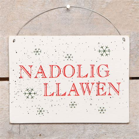 nadolig llawen merry christmas hanging sign by red berry