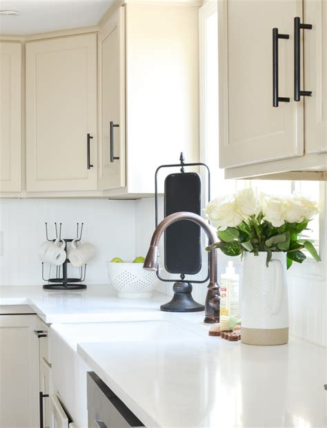 white kitchen cabinets quartz countertops an honest review of our white quartz countertops 1805