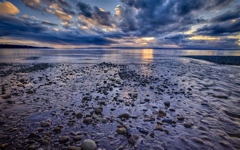ocean rocks stones clouds landscape sky beaches reflection