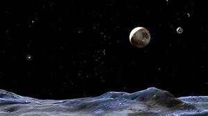NASA's New Images Show Pluto and Its Moon Charon In Color