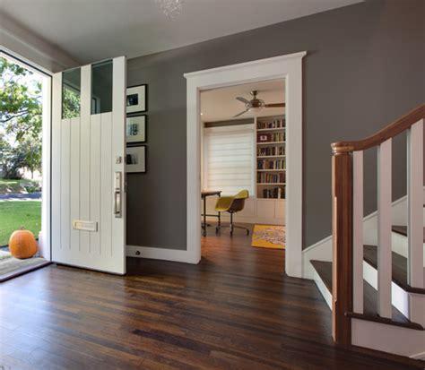 hardwood floors with grey walls base boards sand and sisal