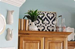 Decorating with books how to recover books with paper for Best brand of paint for kitchen cabinets with 3 part wall art