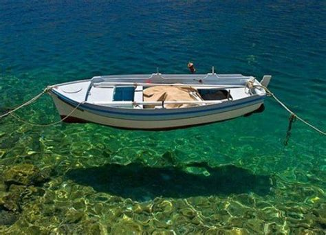 why ship floats on water and doesn t sink boat floating on the crystal clear water pics