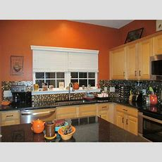 Burnt Orange Kitchen, Black Granite Countertops, Glass