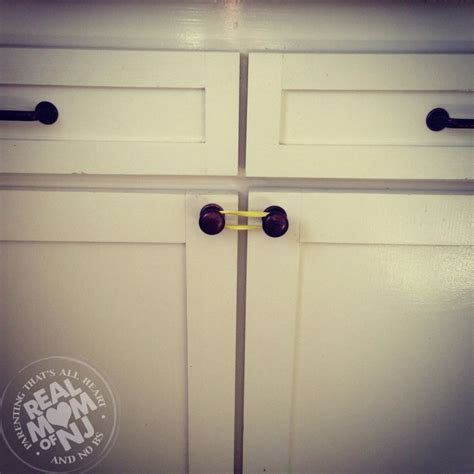 baby proof cabinets diy baby proof cabinets with a rubber band no need for fancy