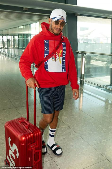 lewis hamilton hilfiger lewis hamilton in hoodie at airport ahead of azerbaijan grand prix daily mail