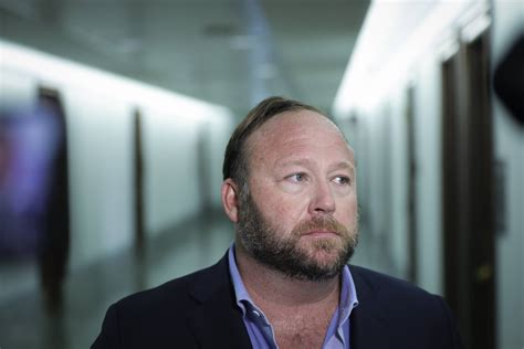 alex jones  hand  documents  sandy hook families