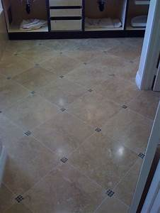 these diagonal bathroom floor tiles have small tile accent With tile bathroom floor
