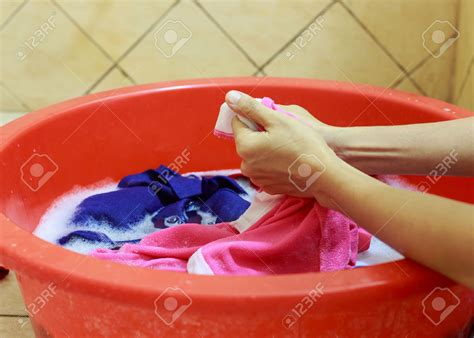 how do you hand wash clothes in a sink hand laundry or machine laundry which do u prefer and why