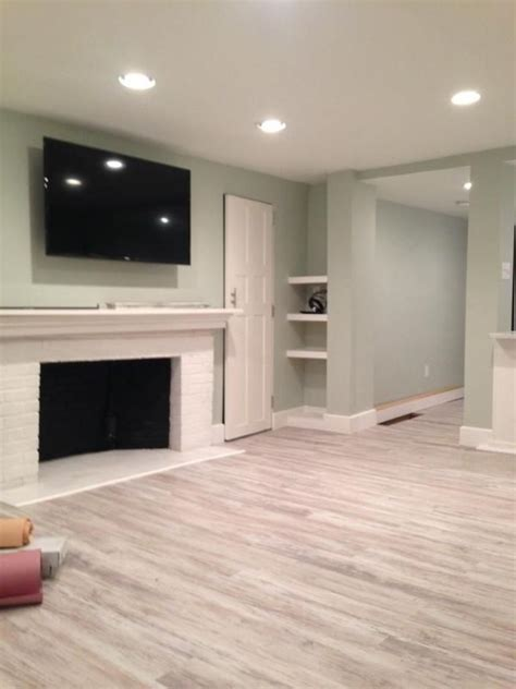 Grey Laminate Floor With Natural Wall Color For Cool