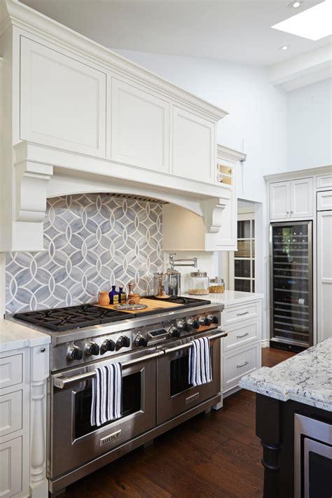geometric tile backsplash adds modern flair  white kitchen hgtv