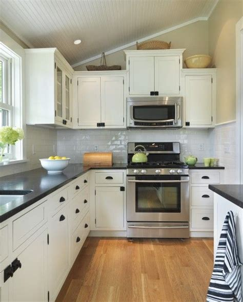 kitchen with white cabinets and black countertops pin by jennifer warner on home design pinterest stove