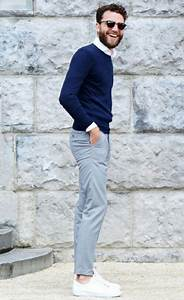 Picture Of grey pants a navy sweater a white shirt and white sneakers