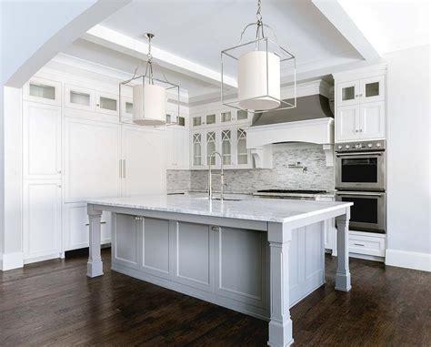 kitchen island leg white and silver iridescent tile backsplash transitional